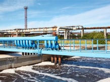 wastewater treatment plant image via Shutterstock.