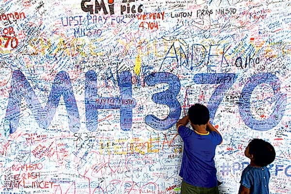 Families demand Malaysia accept MH370 search offer