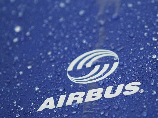 Water drops are pictured on an umbrella with Airbus logo during a protest in front of the Airbus facility in the northern German town of Varel