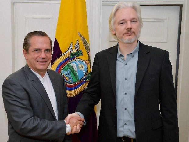 Ecuador's Foreign Minister Ricardo Patino, left, shakes hands with WikiLeaks founder Julian Assange after a press conference inside the Ecuadorian Embassy in London