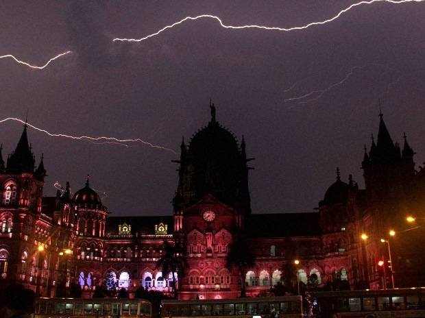 Lightning is seen in the sky above the CST heritage site in Mumbai