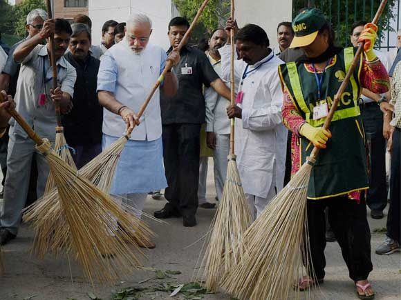 Prime Minister Narendra Modi kicks off the Swachh Bharat campaign in New Delhi's Balmiki Basti on Thursday