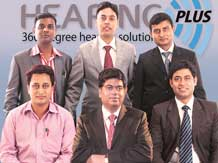 Somenath Mukherjee (centre, foreground), founder, Hearing Plus, with his  team-members