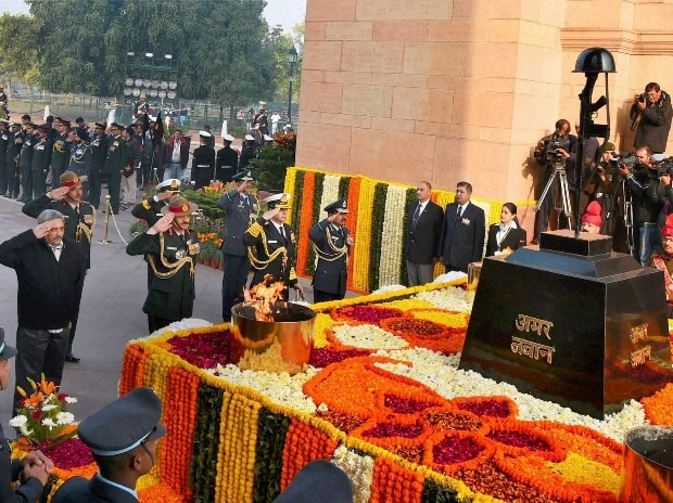 Defence Minister Manohar Parrikar along with  Air Chief Marshal Arup Raha, Naval Chief Admiral RK Dhowan and Army chief Gen Dalbir Singh pays homage to the martyrs at Amar Jawan Jyoti on the occassion of 'Vijay Diwas' in New Delhi on Tuesday