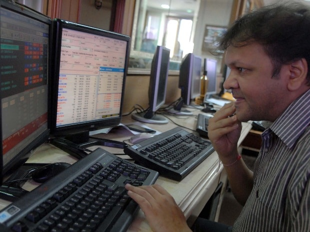 A broker reacts at the BSE in Mumbai as Sensex tumbles over 850 points on Tuesday