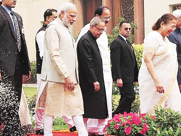 From left: Prime Minister Narendra Modi with President Pranab Mukherjee and others outside Parliament's Central Hall on Monday