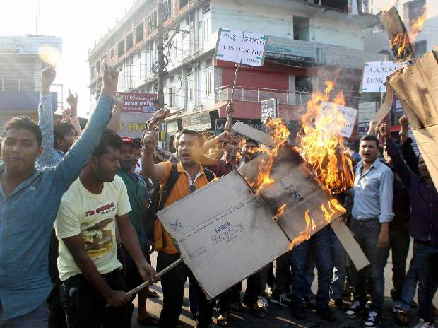 Members of All Assam Minority Students Union (AAMSU) protests against the incident where a mob lynched a rape accused in Dimapur, Nagaland