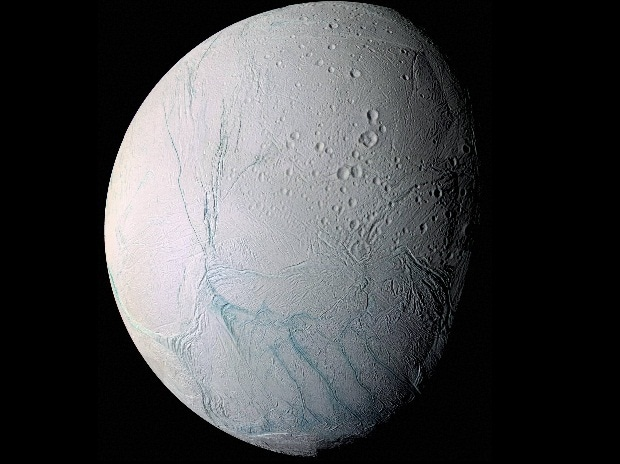 This June 28, 2009 image provided by NASA, taken by the international Cassini spacecraft, shows Enceladus, one of Saturn's moons. A new study published online Wednesday, March 11, 2015, in the journal Nature, suggests there are ongoing interactions.