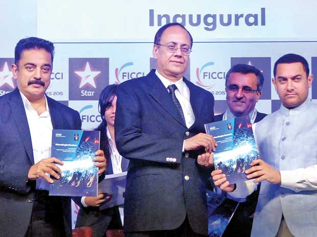 From left: Veteran actor Kamal Haasan, Ministry of Information and Broadcasting Additional Secretary J S Mathur  and Bollywood actor Aamir Khan release the Ficci-KPMG report at the inaugural session of FICCI Frames 2015