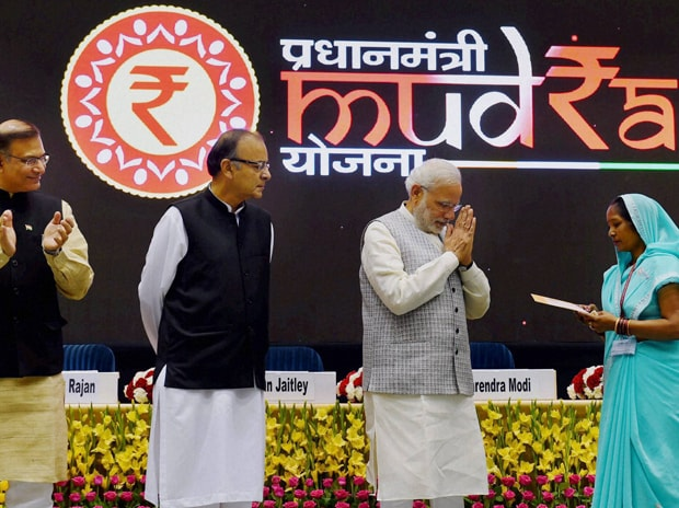 File photo of Prime Minister Narendra Modi after handing over a cheque as Finance Minister Arun Jaitley and MoS for Finance Jayant Sinha look on, at launch of Pradhan Mantri MUDRA Yojana. Picture by PTI