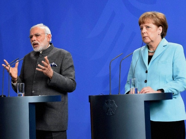 Prime Minister Narendra Modi and German Chancellor Angela Merkel during their joint statement in Berlin, Germany