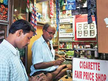 Cigarette shares gain; ITC, VST Industries up ...