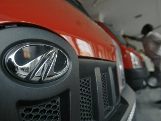 A worker cleans a Mahindra vehicle inside the company's showroom on the outskirts of Agartala, capital of Tripura