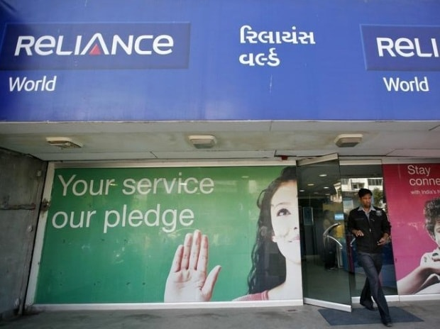 A customer leaves a Reliance communications store ...