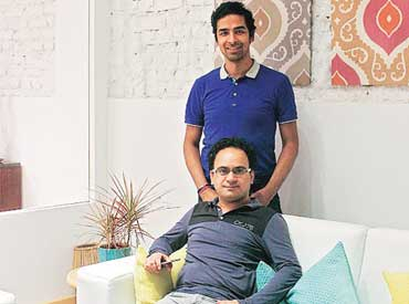 Livspace co-founder and CEO Anuj Srivastava (standing) and  co-founder and director Ramakant Sharma