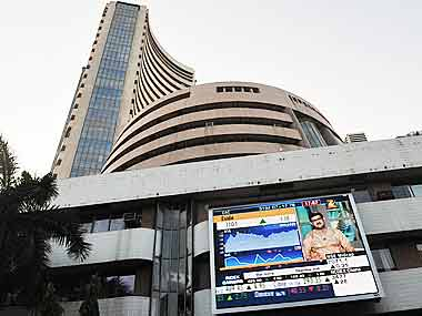Markets likely to open lower tracking mixed global cues; Pfizer, Titan in focus