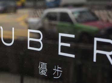 Legal troubles, market realities threaten Uber's global push