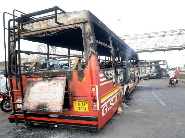 State transport, BRTS buses bore the brunt of Patidar community's angst on Tuesday night and early Wednesday in Ahmedabad (pic: Yasin D)
