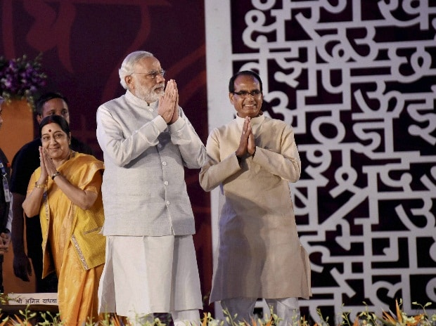 Prime Minister Narendra Modi with External Affairs Minister Sushma Swaraj and Madhya Pradesh Chief Minister Shivraj Singh Chouhan greet  during the inauguration of 10th World Hindi Conference at Lal Parade Ground,  in Bhopal