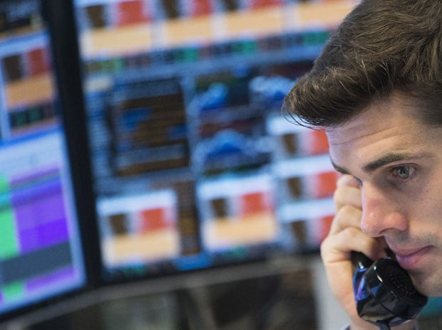 A trader at the trading floor of KBC bank gives a phone call in Brussels, Belgium