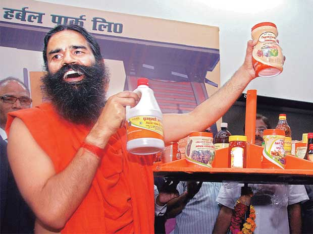 Yoga guru Ramdev with Patanjali Ayurved's products