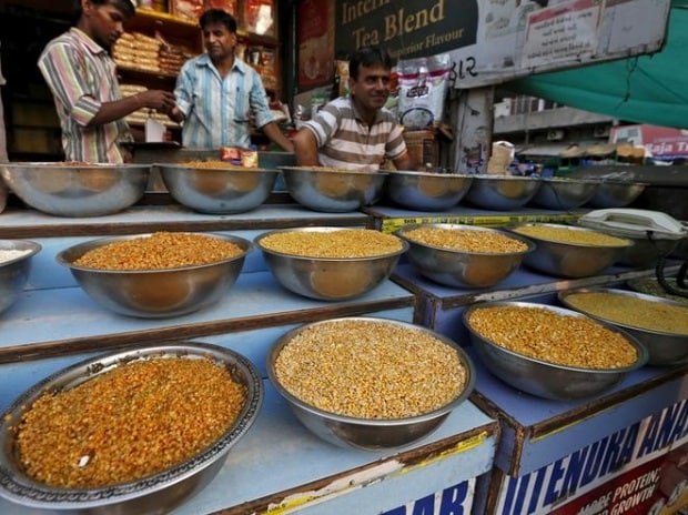 Pulses are kept on display for sale in a shop at a market in Ahmedabad
