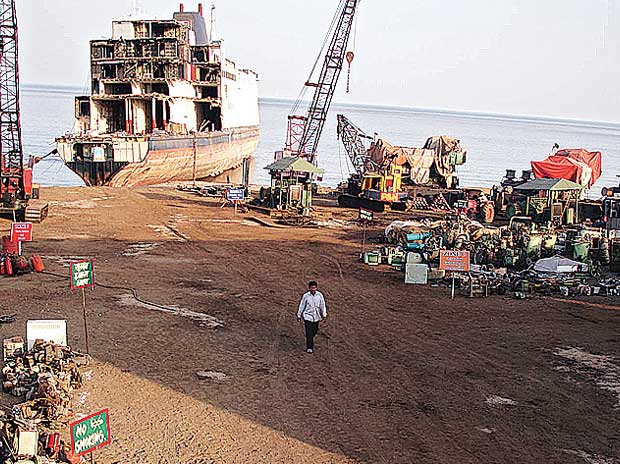 Alang ship breakers slip with the rupee