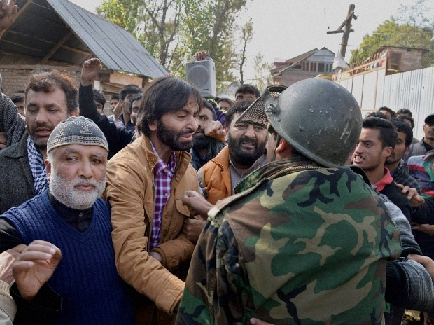 Police arrest JKLF chairman Mohd Yasin Malik along with supporters after he tried to defy restrictions and take out a rally, at Batangoo in Anantnag district