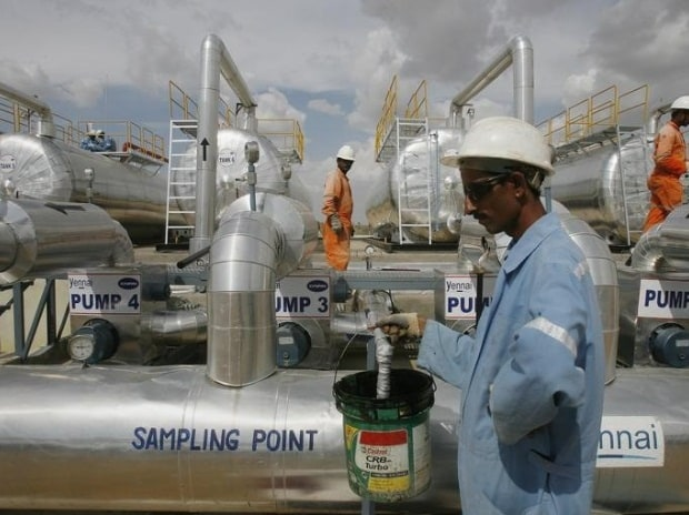 Cairn India employees work at a storage facility for crude oil at Mangala oil field at Barmer in Rajasthan