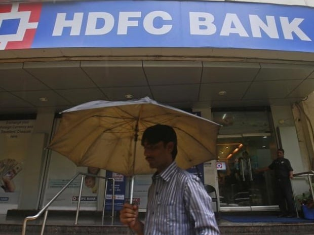 A customer walks outside an HDFC Bank branch in ...