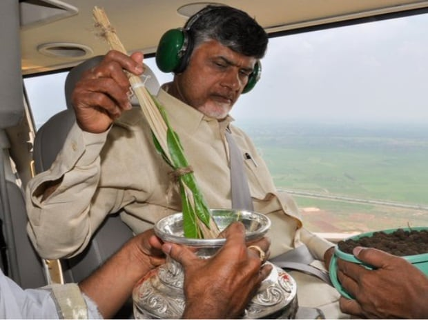 Soil and water being sprinkled over Amaravati