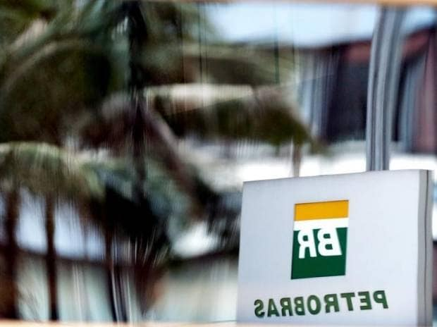 The Petrobras logo is reflected in the window of the company's headquarters in Sao Paulo. File Photo: Reuters