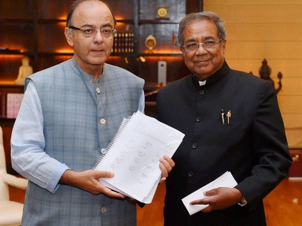 Chairman of the Bankruptcy Law Reforms Committee (BLRC),  T K Viswanathan presenting report to the Union Minister for Finance, Corporate Affairs and Information & Broadcasting, Arun Jaitley, in New Delhi