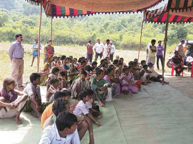Dongaria Kondhs wait to be treated outside a health camp organised by Vedanta in Lanjigarh