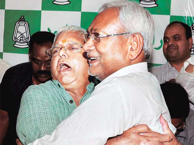 Bihar Chief Minister Nitish Kumar (right) and RJD chief Lalu Prasad greet each other after the Mahagathbandhan's victory in the Bihar Assembly elections on Sunday