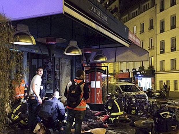 Victims of a shooting attack lay on the pavement outside La Bell Equipe restaurant in Paris, France. Photo: AP/PTI