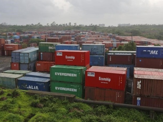 Cargo containers are seen stacked outside the container terminal of Jawaharlal Nehru Port Trust (JNPT) in Mumbai