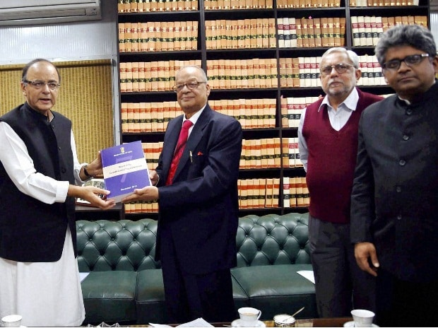 Finance Minister Arun Jaitley receiving the report of Seventh Pay Commission from its Chairman Justice A K Mathur in New Delhi