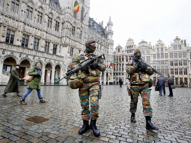 Belgium police officers patrol the Grand Place in central Brussels, Belgium