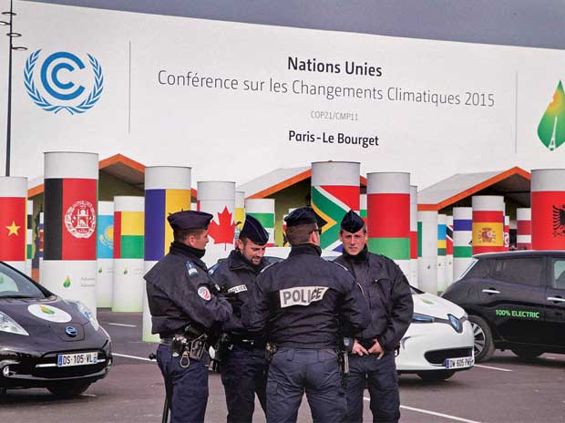Security personnel outside the venue for the United Nations Climate Change Conference that is scheduled to get under way in Paris on Monday