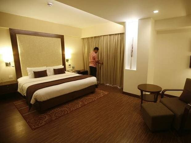 An employee prepares a room for guests at the Four Points hotel in Ahmedabad