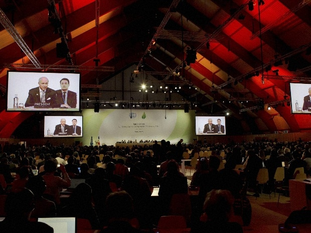 French Foreign affairs minister and acting president of the COP21, Laurent Fabius is seen on giant screens during the 'Committee of Paris' plenary work session at the COP21, United Nations Climate Change Conference in Le Bourget, north of Paris, Fran
