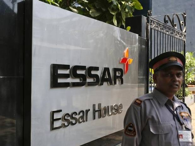 A security guard stands next to an Essar Group ...