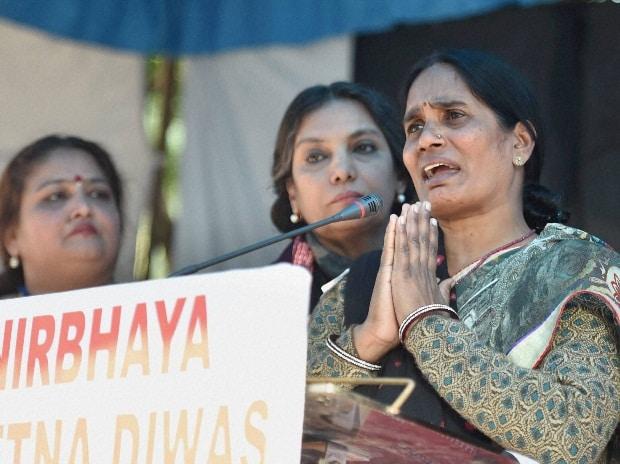 Nirbhaya's Mother Asha Devi addresses at a programme to observe the third anniversary of Nirbhaya gang-rape case as 'Nirbhaya Chetna Divas' at Jantar Mantar in New Delhi. Social activists Shabana Azmi is also seen