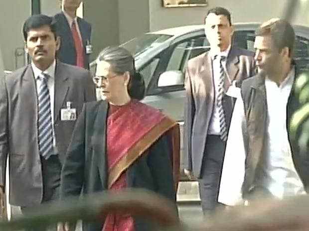Sonia Gandhi and Rahul Gandhi reach party HQ, will address media shortly. Photo: ANI