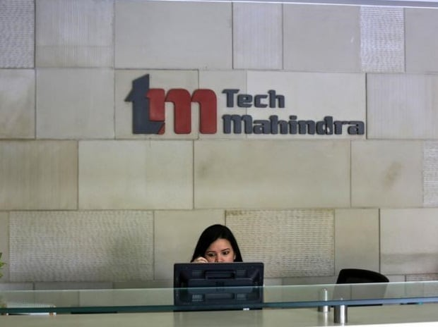 An employee sits at the front desk inside Tech Mahindra office building in Noida on the outskirts of New Delhi