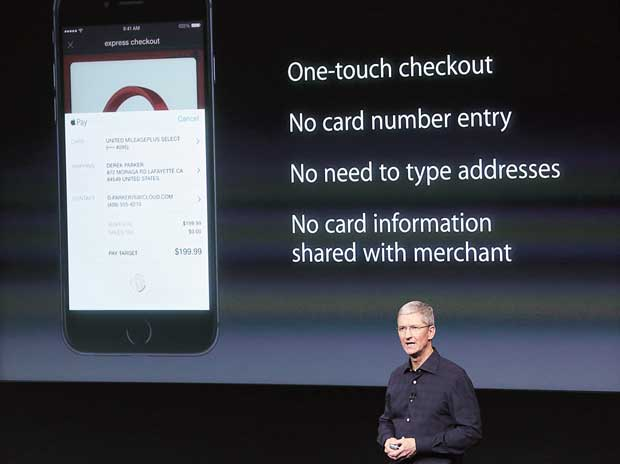Apple CEO Tim Cook speaks about the Apple Pay service during a presentation in 2014. The service will  enter Spain, China, Hong Kong and Singapore next year