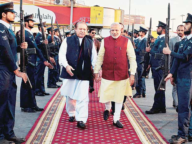 Prime Minister Narendra Modi (right) is received by his Pakistani counterpart, Nawaz Sharif, upon his arrival in Lahore on Friday