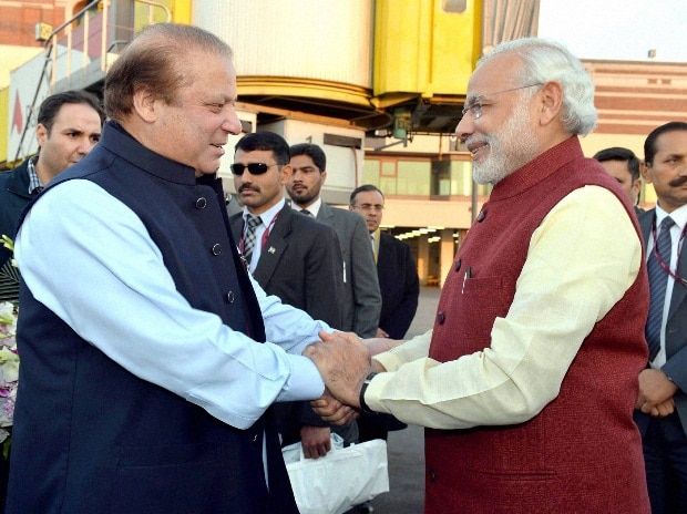 Prime Minister Narendra Modi is greeted by his Pakistani counterpart Nawaz Sharif on his arrival in Lahore