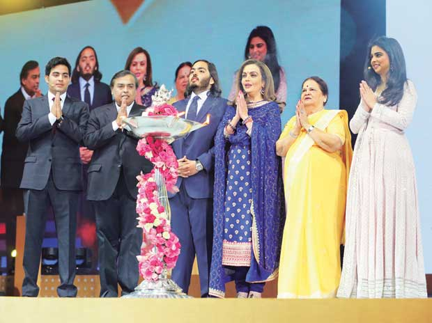RIL Chairman & MD Mukesh Ambani (second from left) flanked by sons Akash (left) and Anant, at the launch of Reliance Jio 4G services in Mumbai on Sunday. (From right) Ambani's daughter Isha, mother Kokilaben and wife Nita